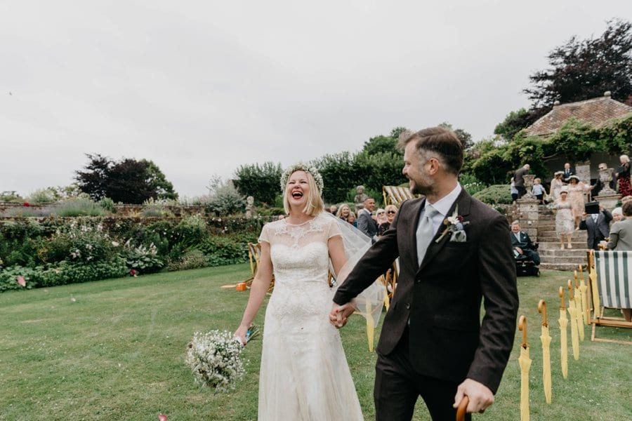 laughing wedding couple
