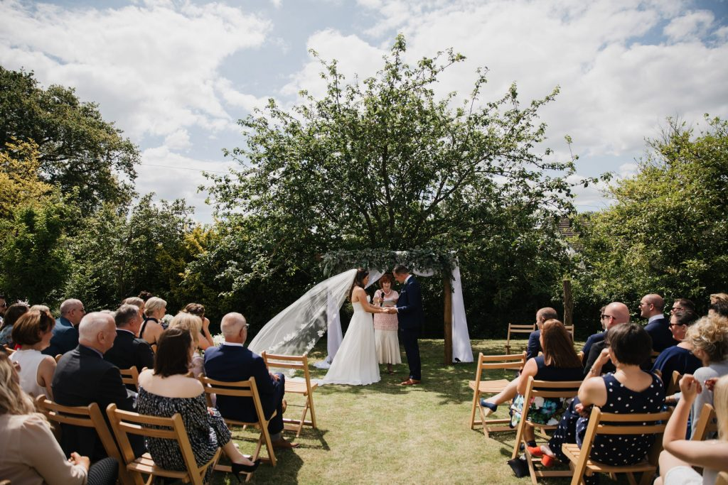 floral arch wedding ceremony