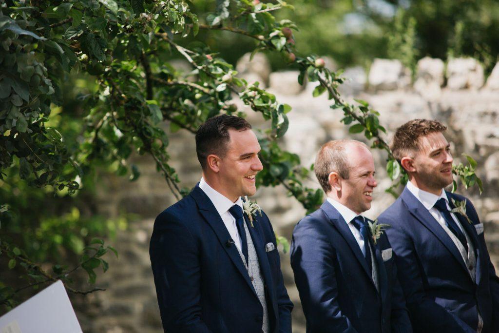 groom watches bride