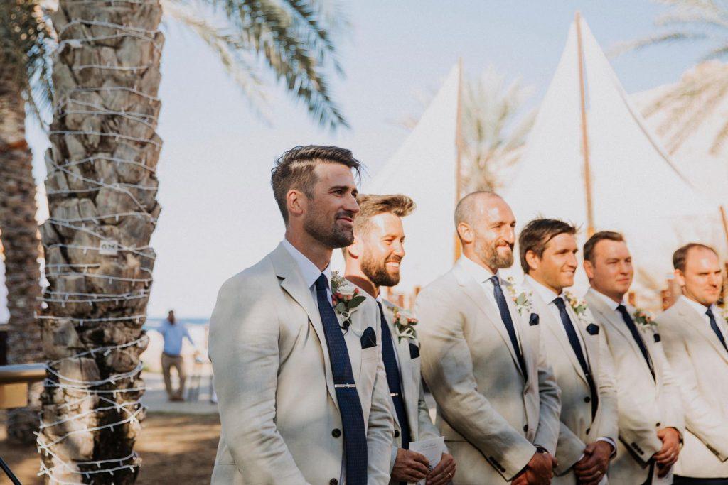 groom at aisle